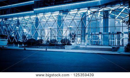 night illuminated working office,blue toned image.