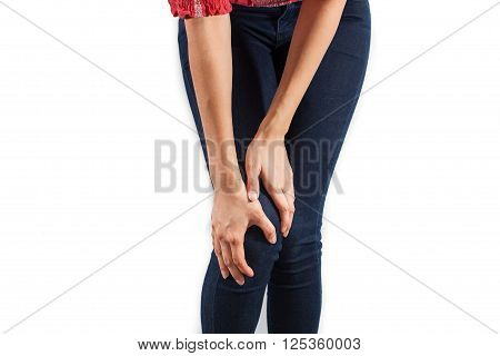 Young beautiful woman with knee-ache on a white background