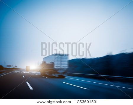 freight car driving on the highway,motion blurred