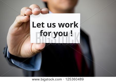 Businessman Presenting 'let Us Work For You'' Word On White Card