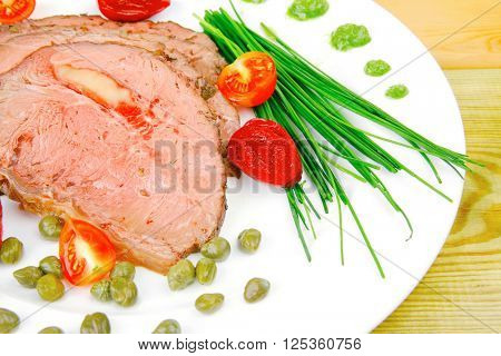 hot ham served on white dish over wood