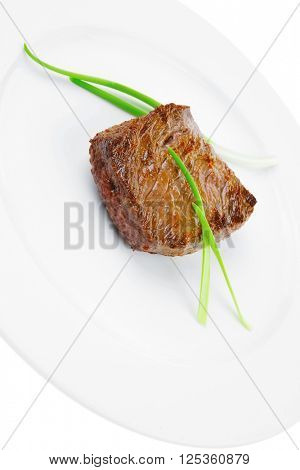 meat savory : grilled beef fillet mignon served on white plate isolated over white background with sprouts