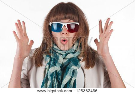 Beautiful young gilr watching 3d television in glasses on a white background