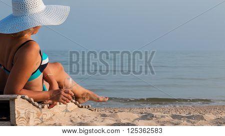 Beautiful woman drinking wine and sunbathing lifestyle