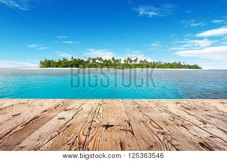 Empty wooden floor and tropical island on background