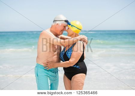 Senior couple with bathing cap at the beach on a sunny day