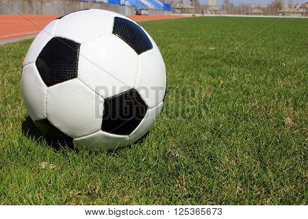 Football on a grass lawn of sports stadium