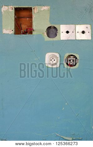 Old socket wall blue interior electrical installation.