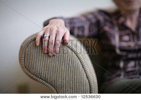 Senior Woman Hand On Armrest