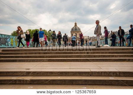 People Passing Of Pont De Arts Bridge, Paris
