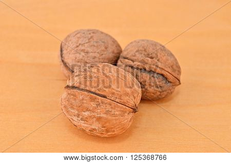 Walnut (Juglans regia) isolated on woooden background