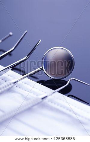 Closeup Of Professional Dental Tools On Shiny Table