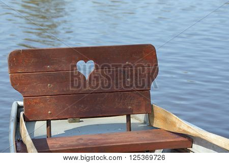 Row boat with heart on a lake
