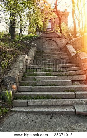 old antique stone stairs to abandoned haunting house