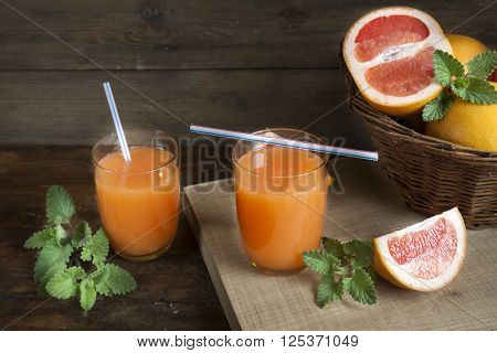 Natural And Fresh Grapefruit Juice In Glass With Freshly Harvested Grapefruit
