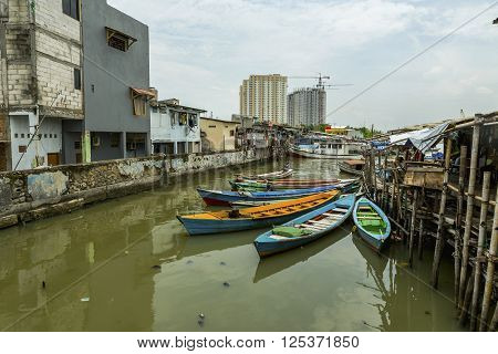JAKARTA, INDONESIA - MARCH 16: Sunda Kelapa old Harbour with fishing boats ship and docks, March 16, 2016,  Jakarta Indonesia.