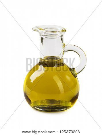 Vegetable oil in a glass carafe isolated on a white background