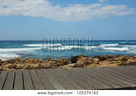 a Wood countertops on the blue sea & sky background