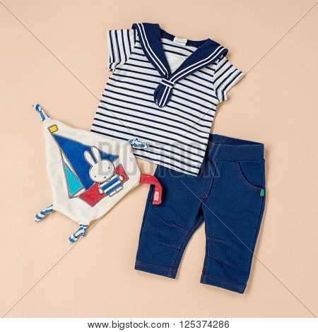 Nautical Themed Toddler Outfit On Beige Surface