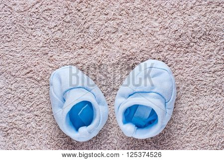 Two Cute Blue Baby Shoes