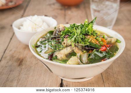 Curry Choy vegetable Curry Rice on wooden floor.Thai style cuisine.