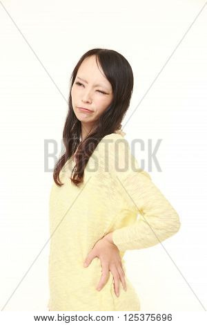 portrait of Japanese woman suffers from lumbago