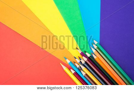 Crayons with colorful paper isolated on white background