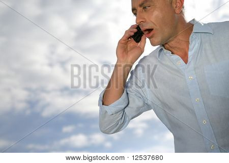 Portrait of an astonished man with a cell phone