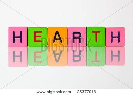 Hearth - an inscription from children's wooden blocks