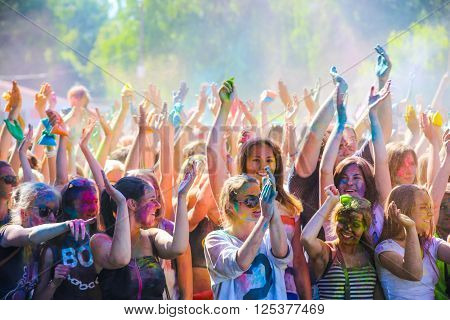 VITEBSK, BELARUS - JULY 4, 2015. Throwing color at the Holi color festival