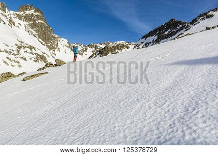 Tourist On A Snow Slope.