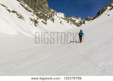 Mountaineer Goes Through The Valley In Winter Conditions.