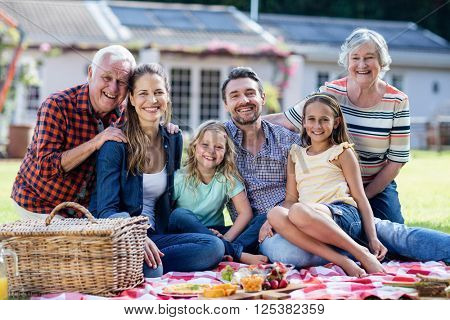 Happy family having a picnic in the garden