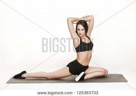Portrait of young attractive woman doing exercises. Brunette with fit body on yoga mat. Healthy lifestyle and sports concept. Series of exercise poses.