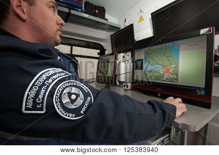 Saint-Petersburg Russia - April 6 2016: Mobile point of Intelligence radiological accidents in the area with the help of robotics and unmanned vehicles. On the map monitors - conditionally contaminated areas. Equipped with a special car.
