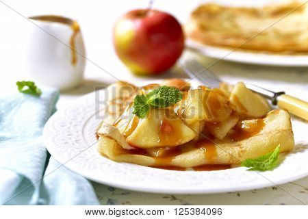 Pancakes With Caramelized Apple And Caramel Sauce.