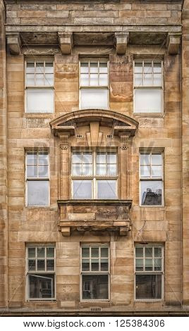 The facade of one of the more ornate tenements in Glasgow city centre Scotland.