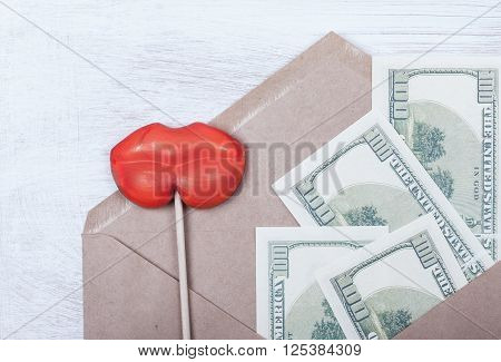 symbol of selling love and money bribe. money and women's lips in the envelope