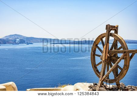 Spinning wheel in the stunningly beautiful town of Oia with a commanding view over the caldera of Santorini Greece.