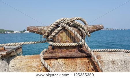 Mooring cleat and rope on the port