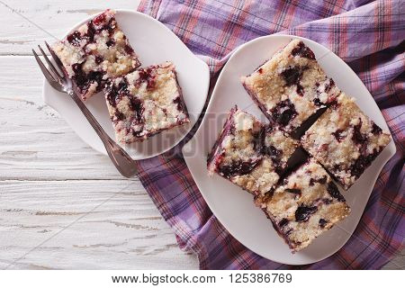 Sponge Cake With Blueberries Close-up On A Plate. Horizontal Top View