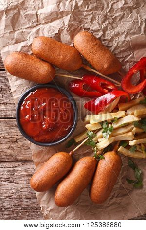 Fast Food: Corn Dogs, French Fries And Ketchup Close-up. Vertical Top View