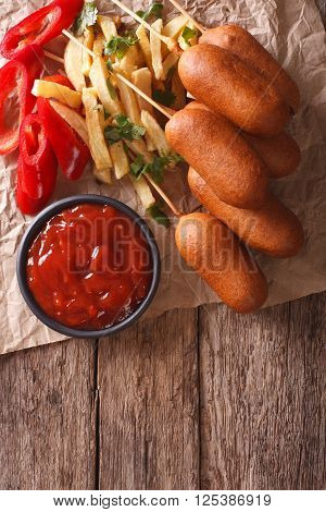 Corn Dogs, French Fries, Pepper And Ketchup. Vertical Top View