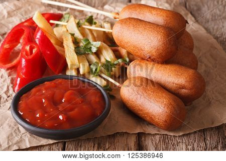 Corn Dogs, French Fries, Pepper And Ketchup Close-up. Horizontal