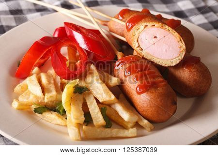 Corn Dog With Fries And Vegetables On A Plate Close-up. Horizontal