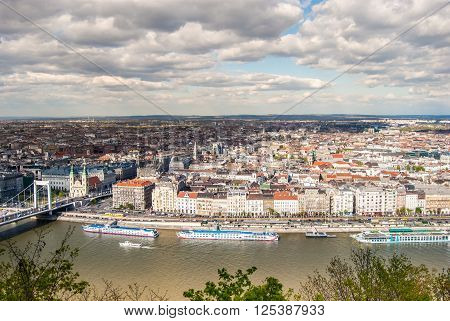 Peautiful panorama of Budapest city with Danube river, bridges and boats, Hungary. Cityscape with blue sky and gorgeous clouds. ** Note: Soft Focus at 100%, best at smaller sizes