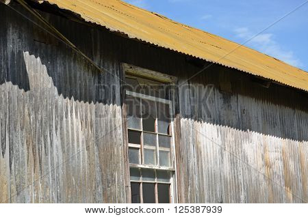 Old building with gold painted roof casting a shadow