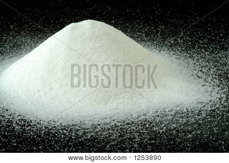 A Mountain Of Granulated Sugar On A Black Background