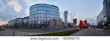 Warsaw, Poland - March 28, 2016: Kasprzaka street, Office building Warsaw Spire under construction in Warsaw, Poland. Warsaw Spire is a modern landmark and a powerful symbol of Warsaws energy.