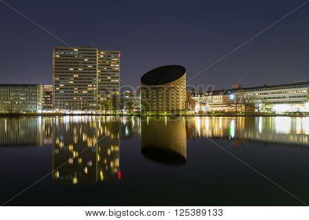 Copenhagen, Denmark - April 09, 2016: Tycho Brahe Planetarium and Lake Sankt Joergens by night.